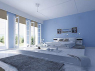 Comfortable minimalist light blue bedroom