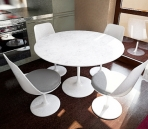 Combination of simple white tables and chairs (including maps)